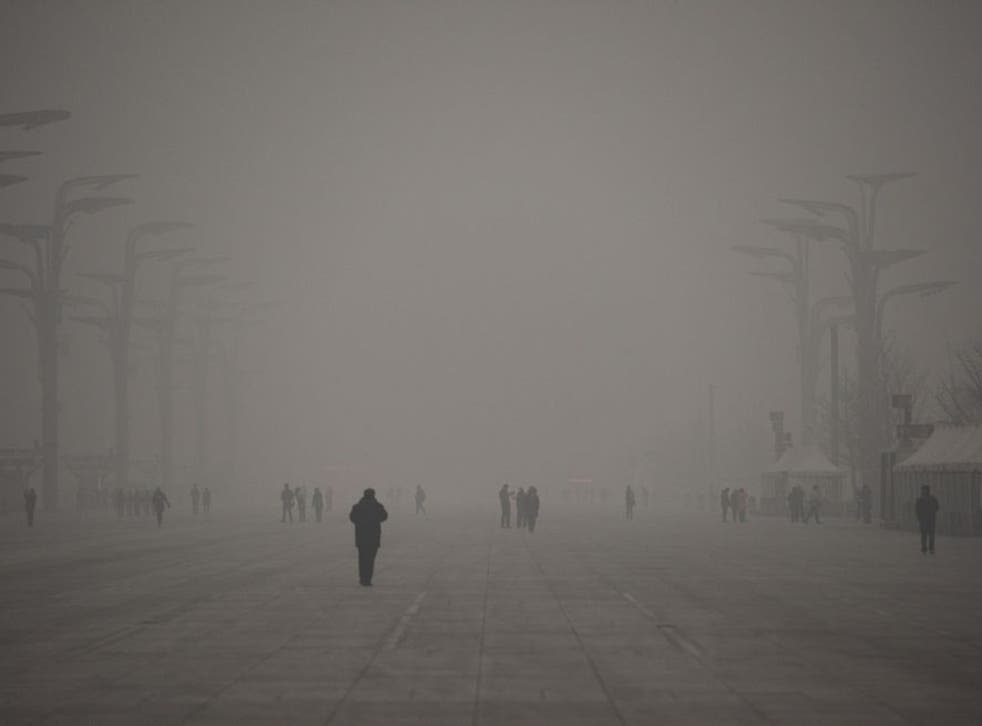 A thick grey haze shrouded Beijing, with the concentration of PM 2.5, harmful microscopic particles that penetrate deep into the lungs, on 1 December