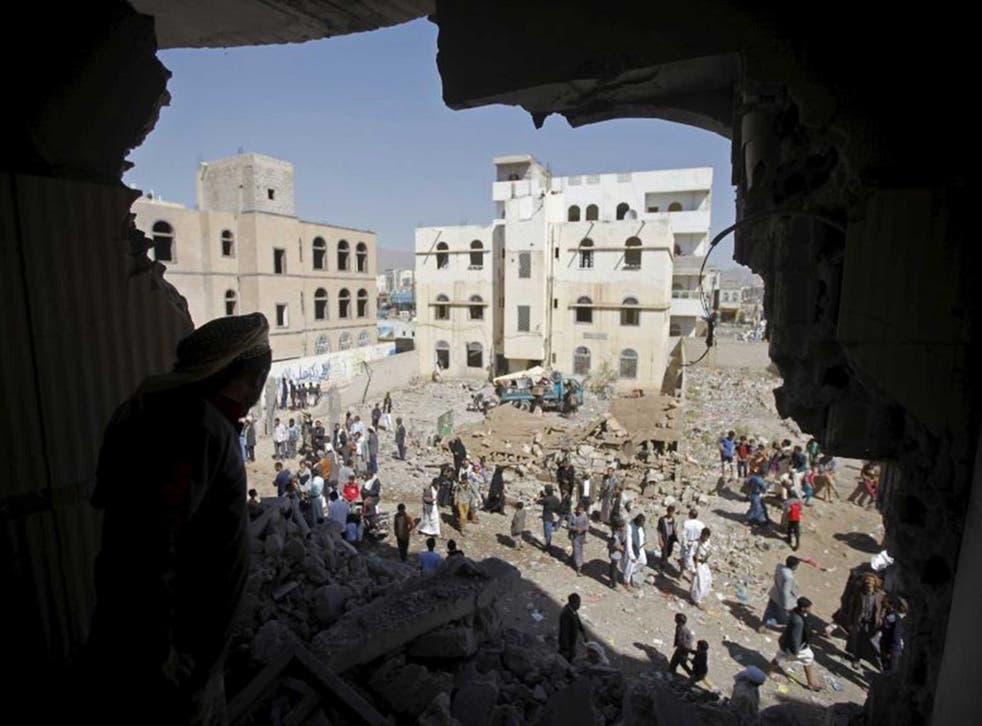 A man surveys the damage in a Sanaa neighbourhood
