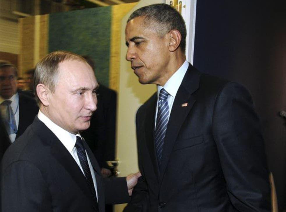 Russian President Vladimir Putin meets U.S. President Barack Obama during the World Climate Change Conference 2015