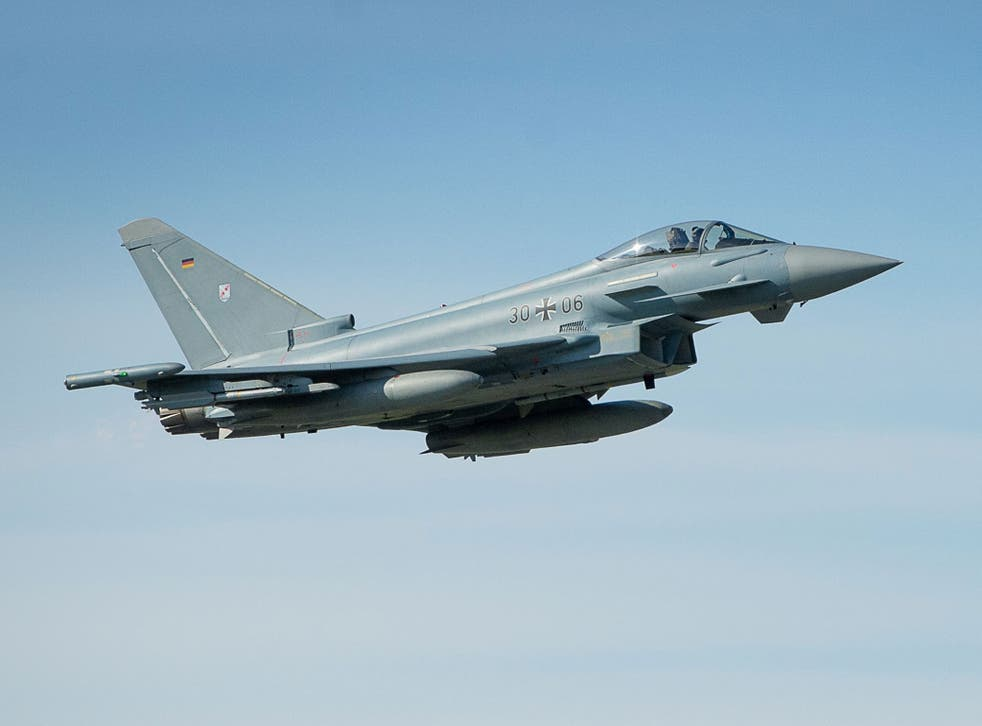 A German Eurofighter Typhoon makes a fly-by during the visit of of German air force chief Lieutenant general Karl Muellner at the Amari Air Base in Harjumaa, Estonia on September 9, 2015.