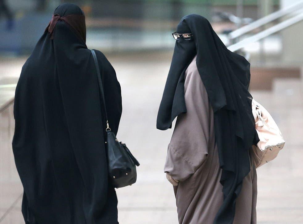 Two women wearing Islamic veils