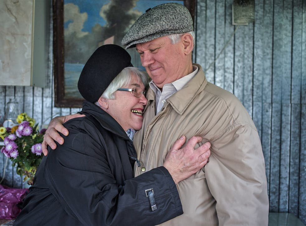 Alexei Koptev, with his wife Lyubov, faces six years in prison after being found guilty of trying to revive the 'extremist' Jehovah's Witnesses in Taganrog