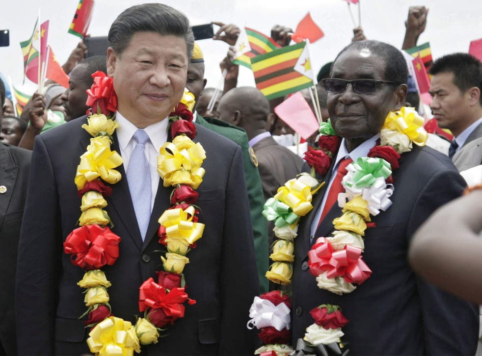 Chinese President Xi Jinping was greeted by Robert Mugabe in Harare