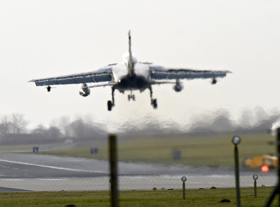 A German Tornado combat aircraft of at an air base in Jagel. Germany has approved plans to assist in the air strikes against the Isis