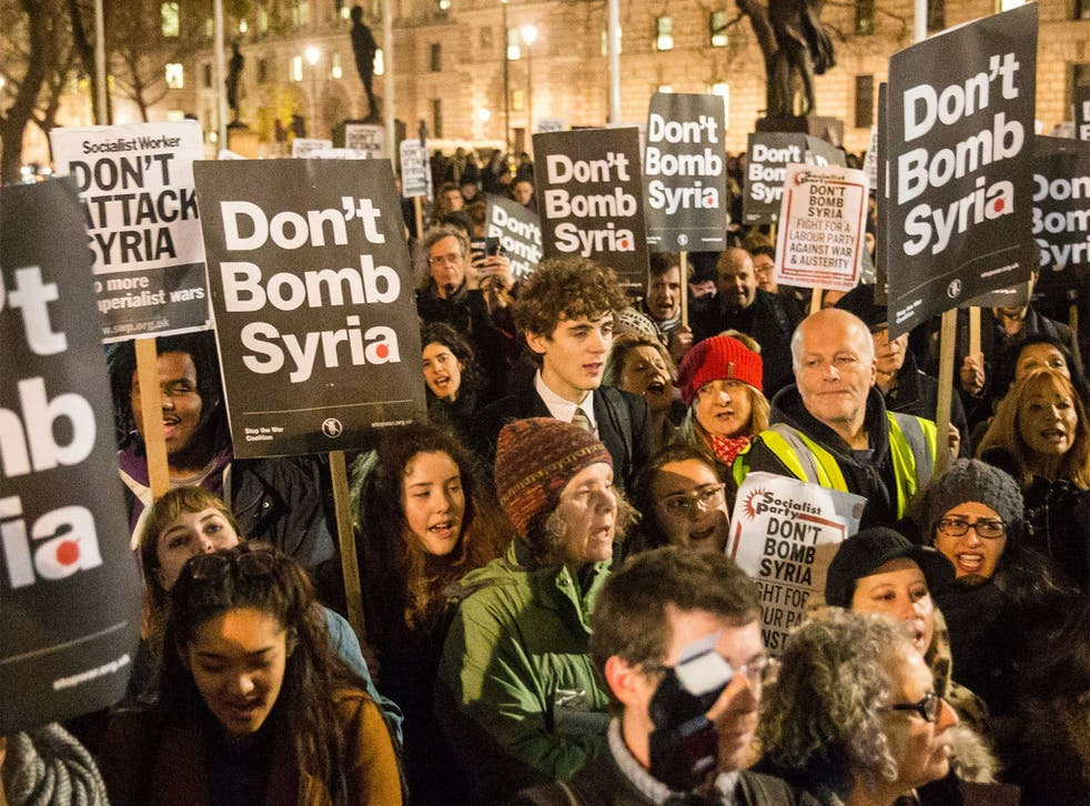 'Stop the War' supporters protest against plans to extend British air strikes against Isis from Iraq into Syria, in Parliament Square, London