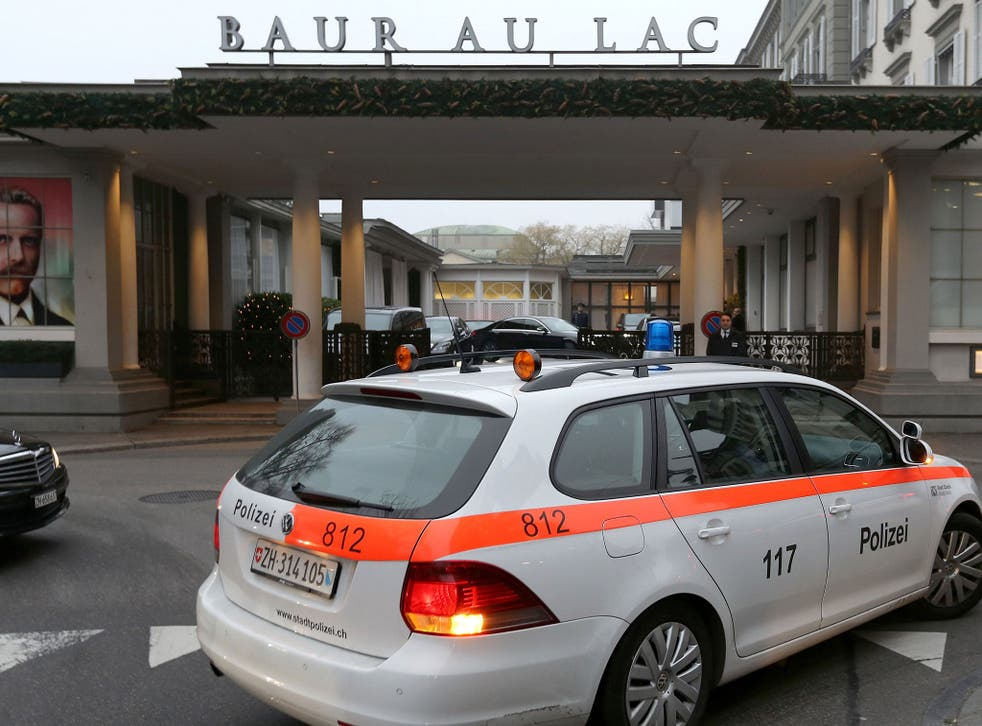 A police car in front of the entrance of the Hotel Baur au Lac in Zurich, where Swiss authorities conducted an early-morning operation to arrest several Fifa football officials on 3 December