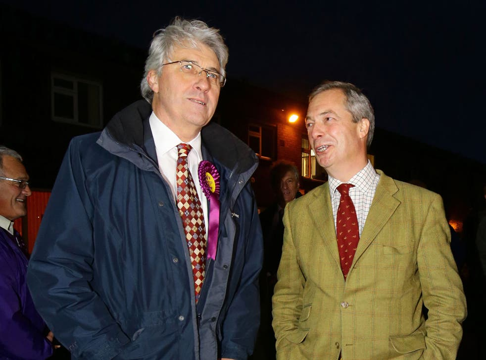 John Bickley, left, Ukip candidate for Oldham West and Royton talks to Ukip Leader Nigel Farage before a visit to a local polling station during the final few hours of voting in the by-election