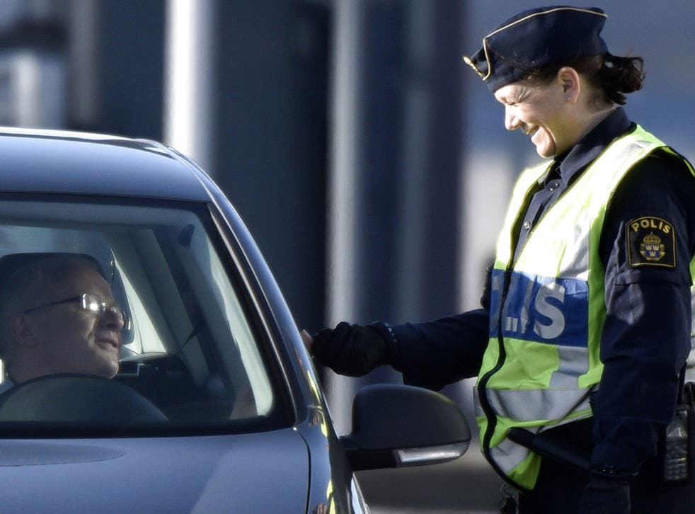 A police officer checks legitimation from a driver from Denmark at Lernacken on the Swedish side of the Oresund strait November 12, 2015.