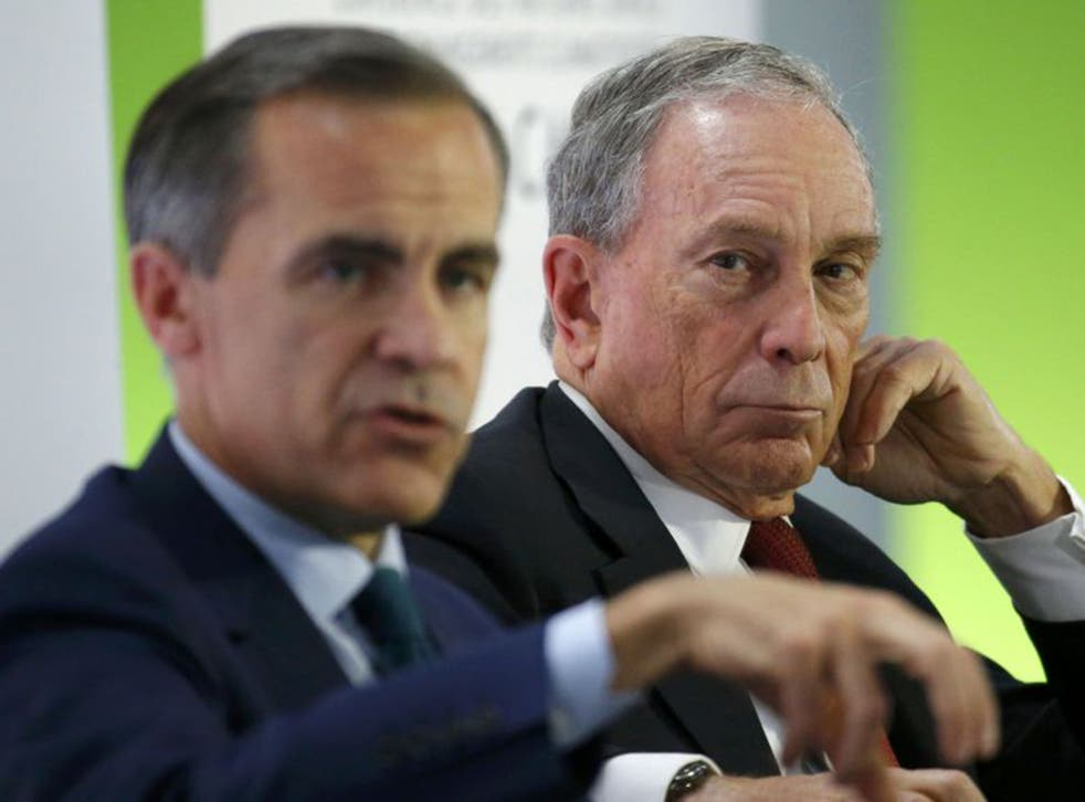 Bank of England governor Mark Carney (L) and former New York City Mayor Michael Bloomberg attend a meeting during the World Climate Change Conference 2015