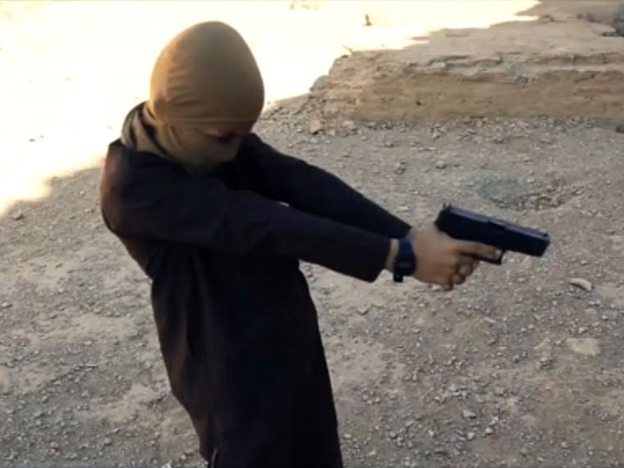 Isis uses young boys to hunt down and kill prisoners in ruined Syrian castle for gory propaganda