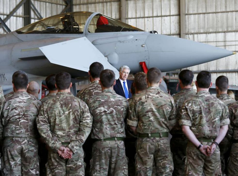 Michael Fallon, the Defence Secretary, speaks to RAF personnel in Cyprus