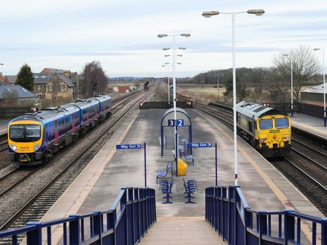 Two trains pass through Church Fenton, North Yorkshire where it is proposed the HS2 railway will link with the East Coast Mainline