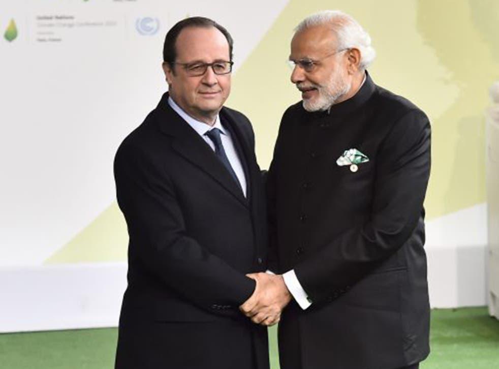 François Hollande of France welcomes Narendra Modi of India on Monday