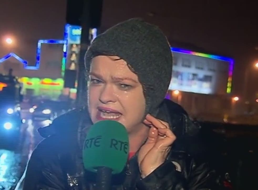 TV presenter Teresa Mannion braces herself in the middle of Storm Desmond