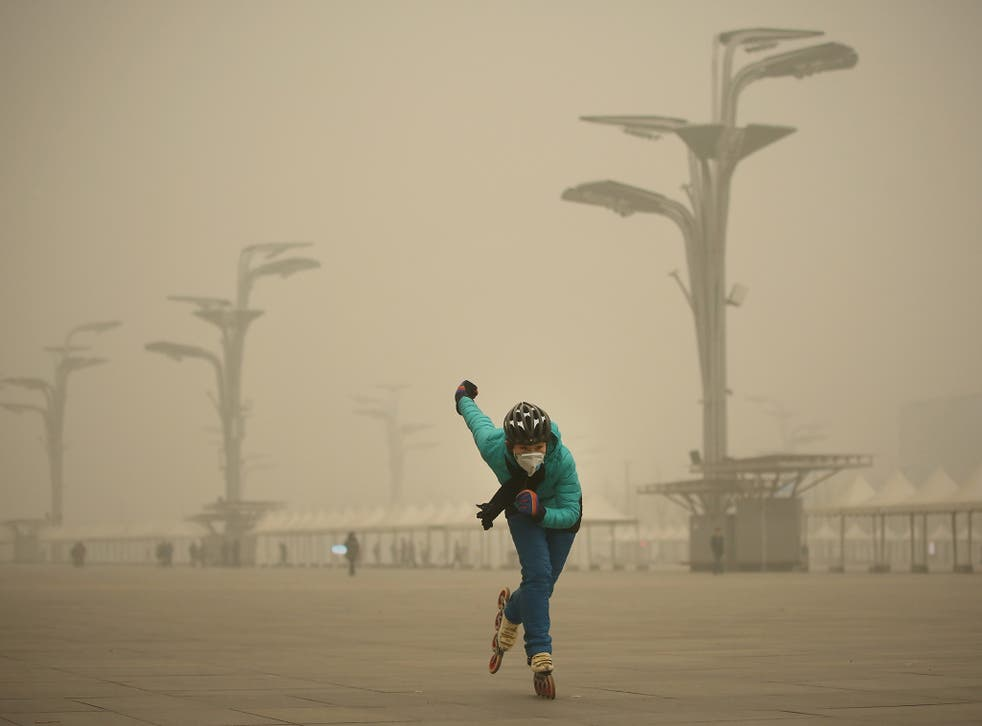 A rollerblader dons a mask to practise at Beijing's Olympic Park