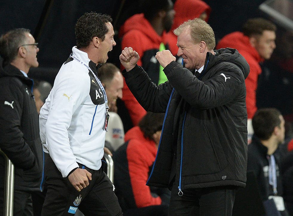 The Newcastle coach, Steve McClaren, right, celebrates after their second goal wrapped up victory