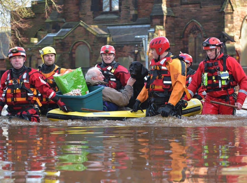 A rescue team helps to evacuate people from their homes after Storm Desmond caused flooding in Carlisle. Storm Desmond has brought severe disruption to areas of northern England as dozens of flood warnings remain in place