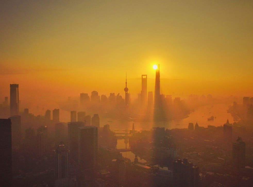Skyscrapers and high-rise buildings in Pudong at sunrise in heavy smog in Shanghai