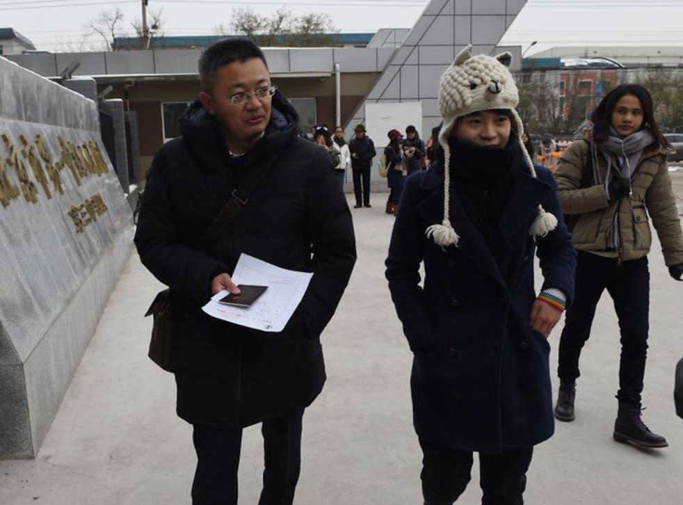 Qiu Bai, right,and her lawyer, Wang Zhenyu, at Beijing People's Court