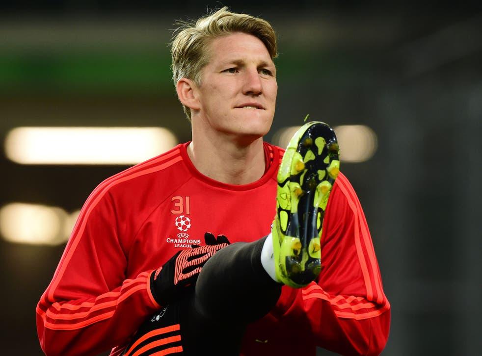Bastian Schweinsteiger warms up during Manchester United training