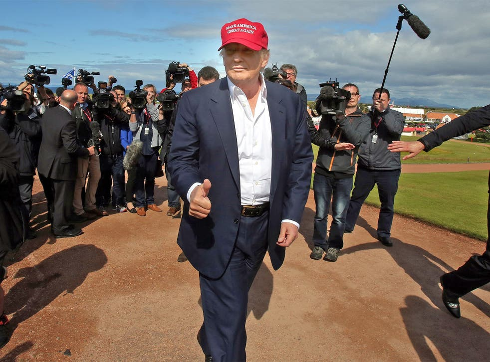 Donald Trump, pictured at the 2015 Women's British Open at Turnberry, says London police fear for their lives