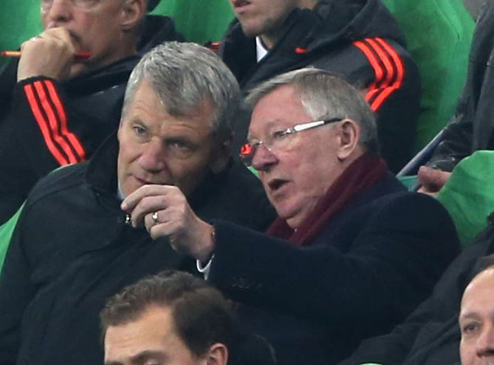 Former Chief Executive David Gill and former manager Sir Alex Ferguson of Manchester United watch from the directors' box