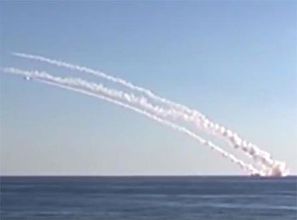 Image from footage taken from Russian Defense Ministry official website shows cruise missiles launching from Rostov-on-Don submarine at eastern Mediterranean Sea in a direction of Syria. Cannot be independently verified by AP.