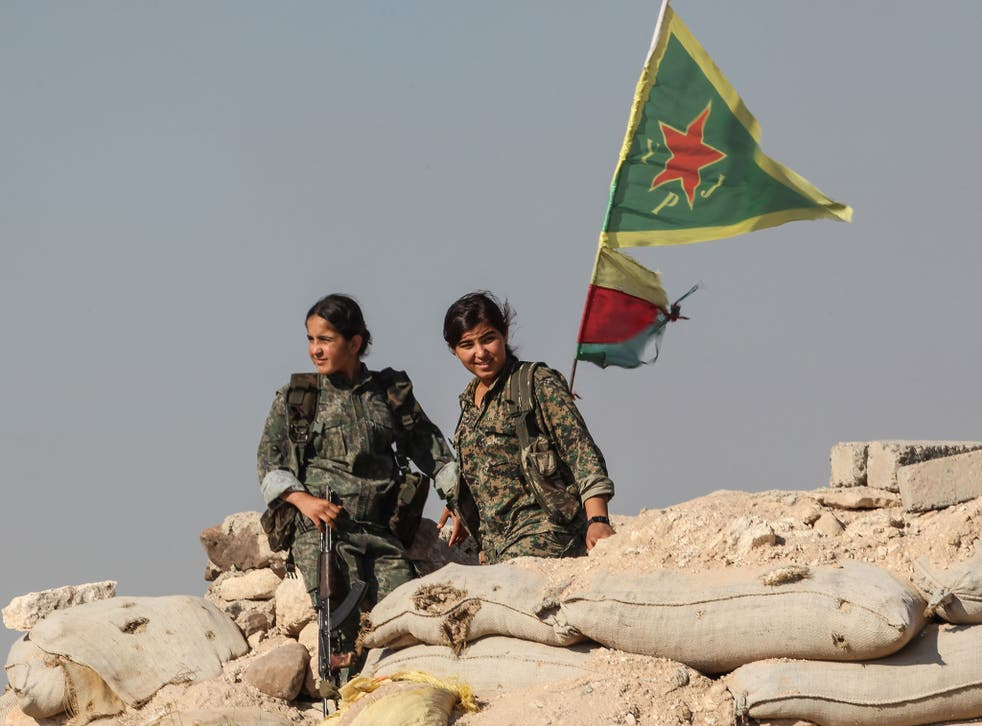 Kurdish People's Protection Units at a checkpoint in the outskirts of Ain al-Arab in 2015