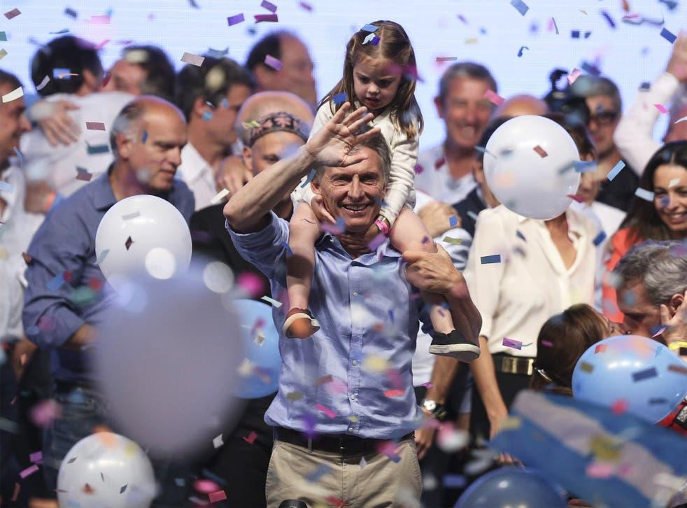 Mauricio Macri celebrates winning last month's election