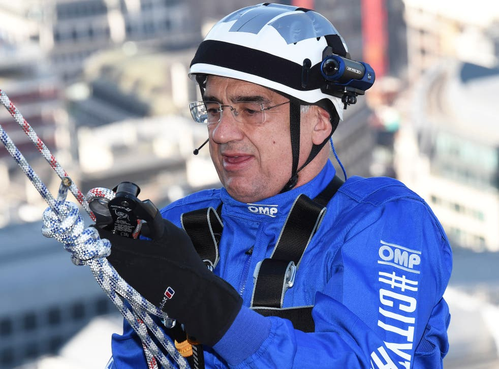 GWPF financial backer Sir Michael Hintze abseils down the Gherkin during a charity event in September