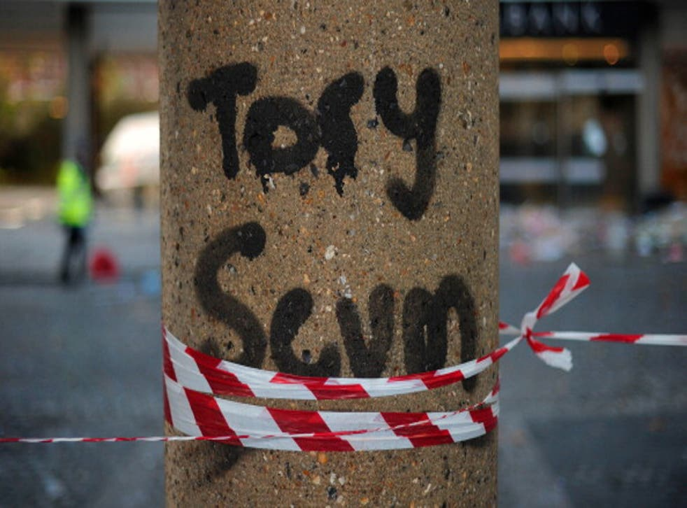 Graffiti on a pillar outside of the damaged Conservative Party HQ in 2010 when students stormed the building in protest over plans to increase tuition fees, branding David Cameron 'completely unacceptable'