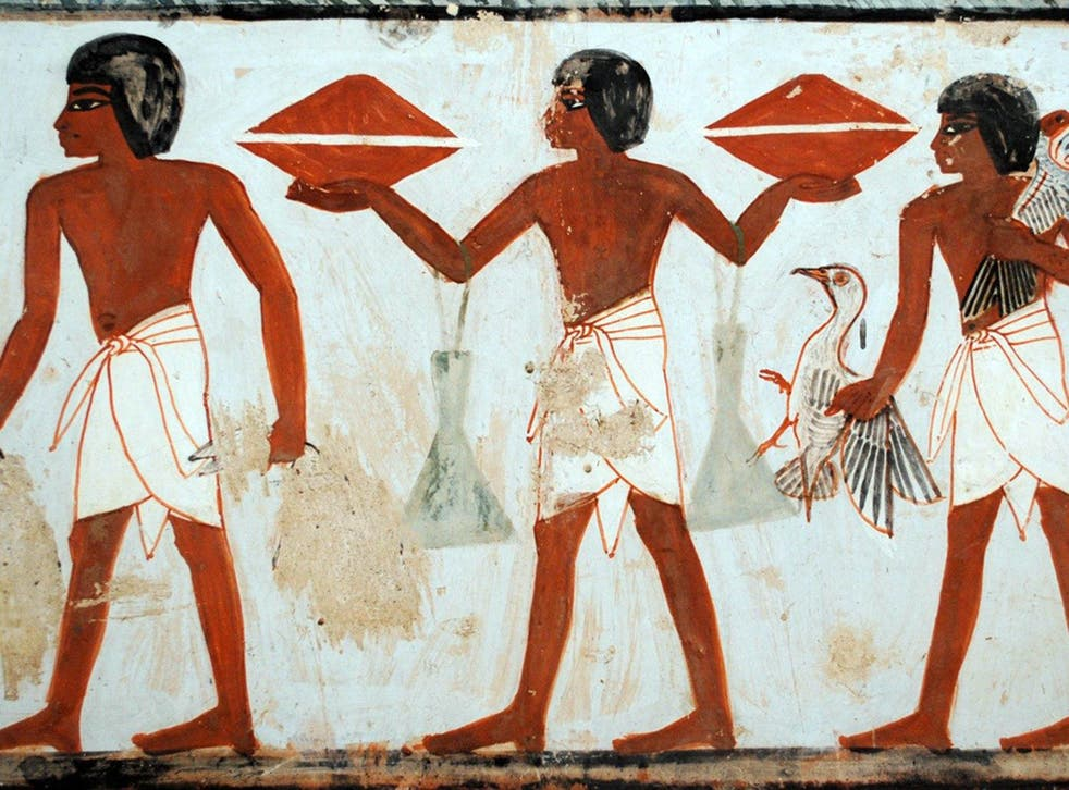 A porter carrying two containers of honey in the tomb of Menna