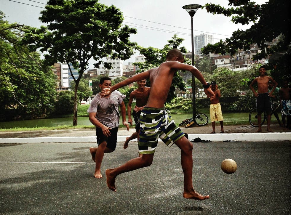boys playing street football during the FIFA Confederations Cup Brazil 2013
