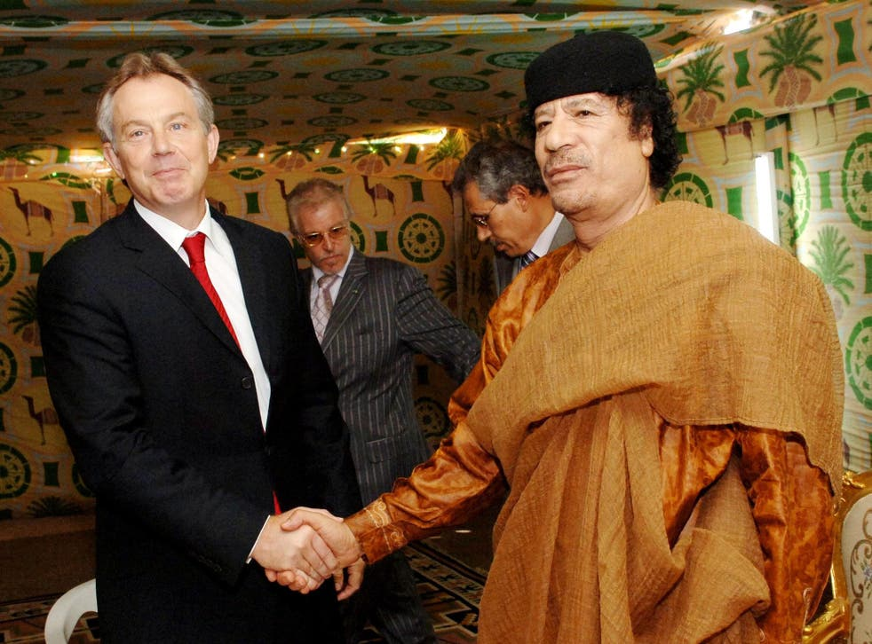 Tony Blair and Colonel Gaddafi shake hands during the famous 2004 'deal in the desert'