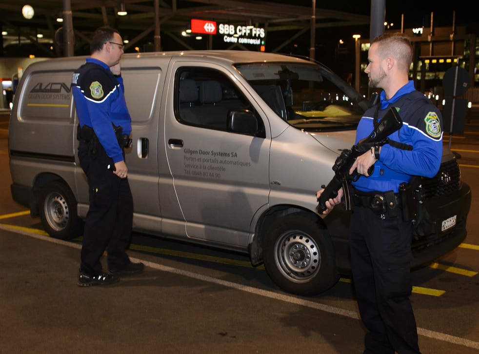 Security officers check a van at Geneva's airport on 10 December, 2015, after police raised the alert level and searched the city for several suspected jihadists believed to have links to Isis