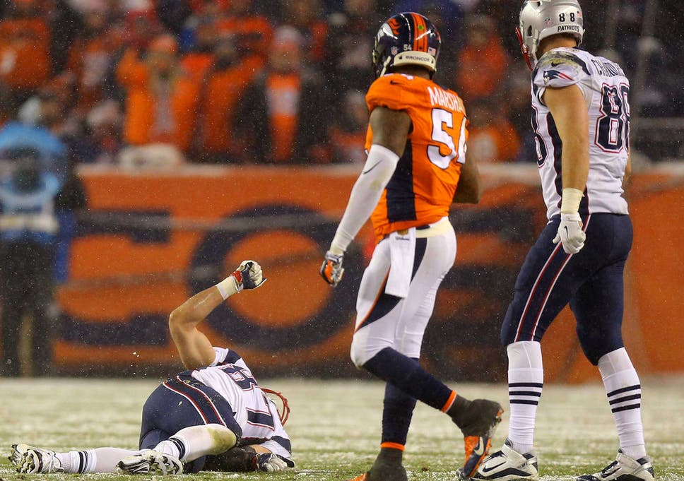 9c843cc14 Tight end Rob Gronkowski  87 of the New England Patriots lies on the field  injured