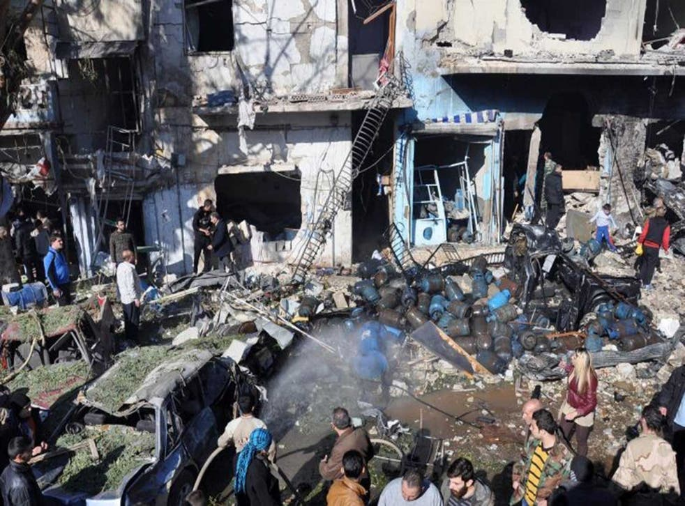 Residents scramble to assess the damage following the car bomb