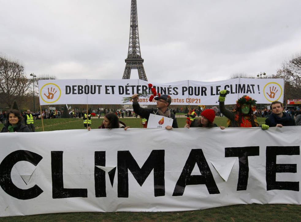 Environmentalists attend a demonstration near the Eiffel Tower in Paris, France, during the World Climate Change Conference 2015