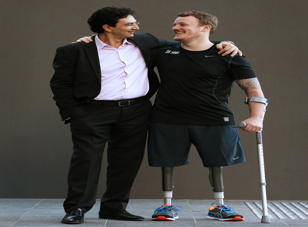 Dr Munjed Al Muderis, left, performed the the osseointegration procedure on amputee Michael Swain, right
