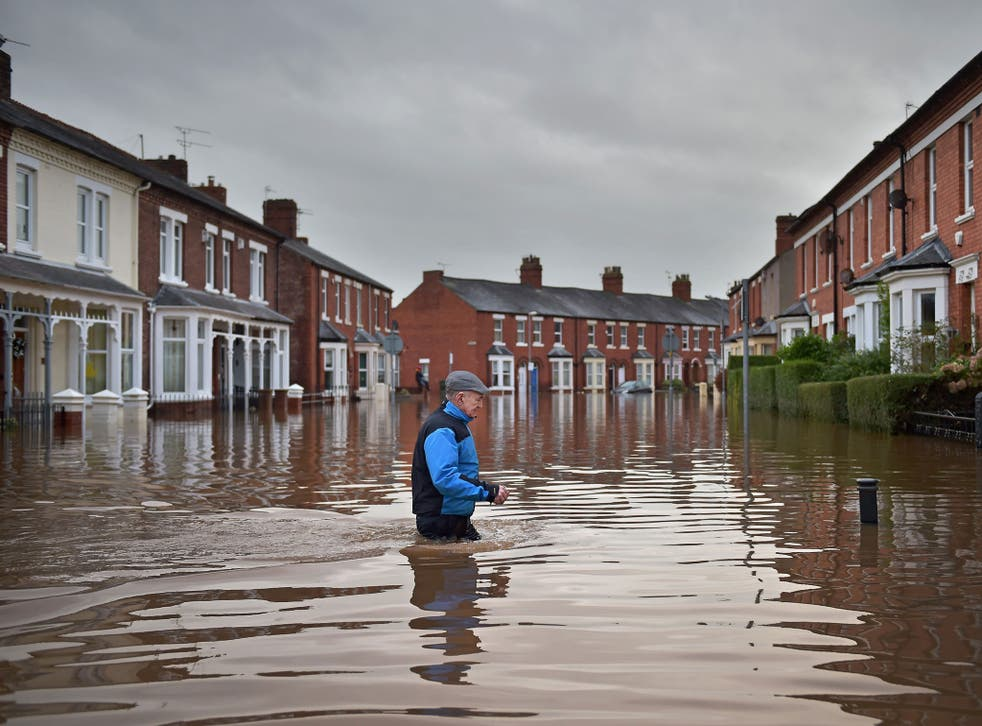 Flooding, like these scenes from northern England, will get worse under the government's environment and climate policies.