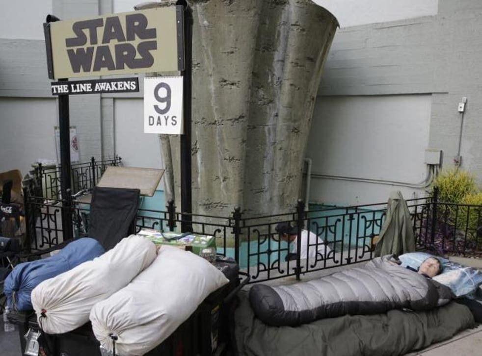 Caroline Ritter sleeps while waiting first in line for a chance to see The Force Awakens. She is planning to get married  before the premiere of the film.