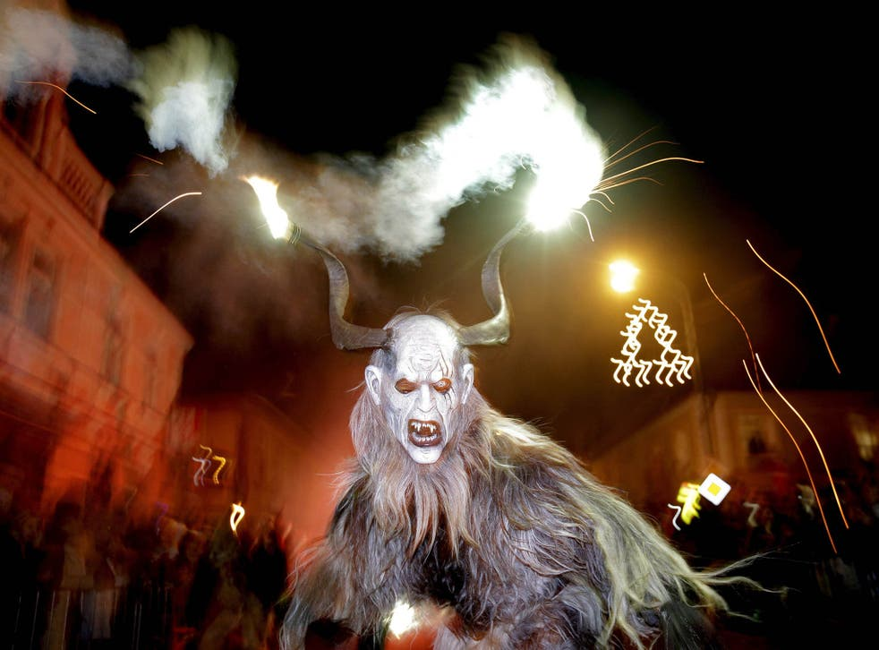 A man dressed as a devil performs during a Krampus show in the southern Bohemian town of Kaplice