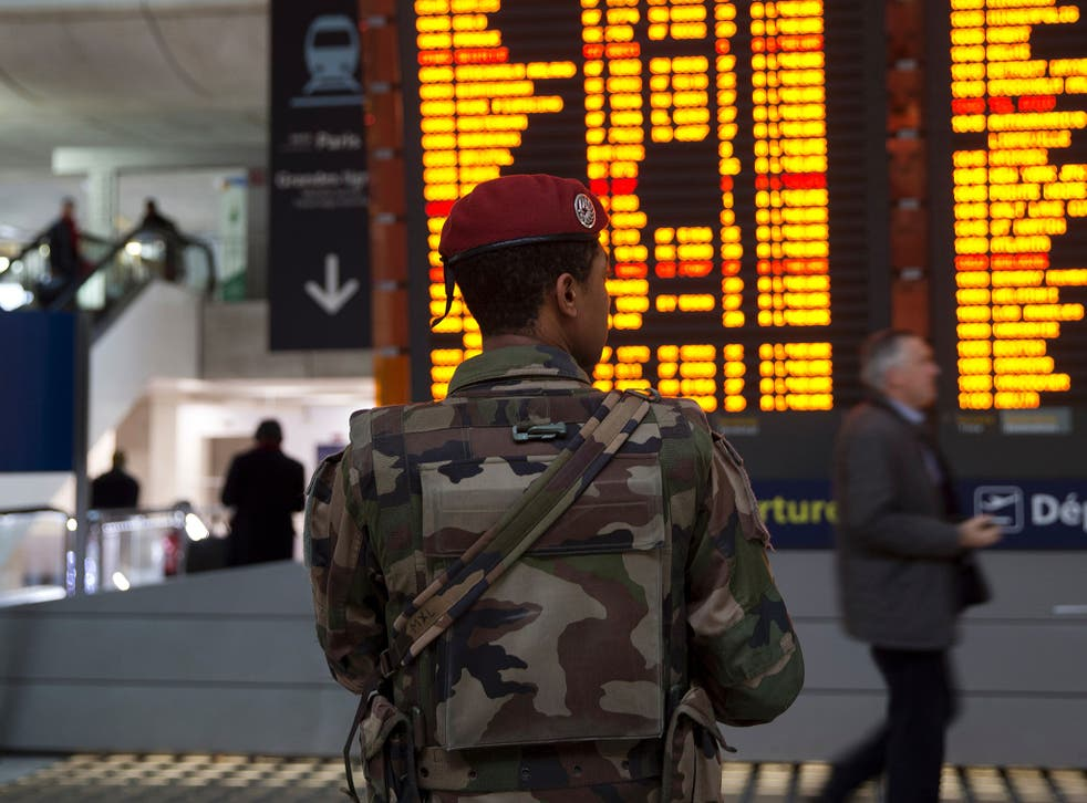 A French soldier patrols at the Charles de Gaulle airport amid heightened security levels on 3 December