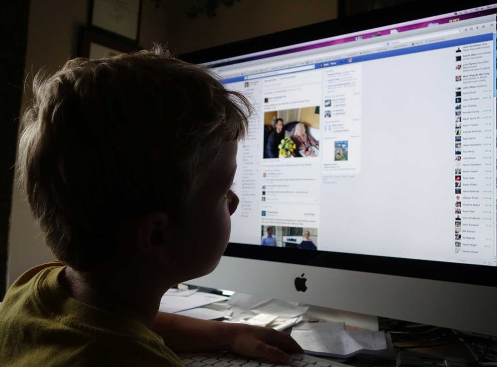 A child examines his Facebook homepage