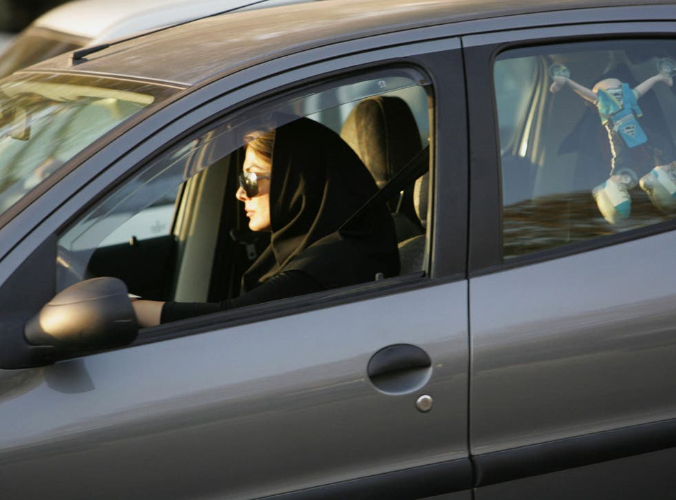 File: A woman drives her car in Iran