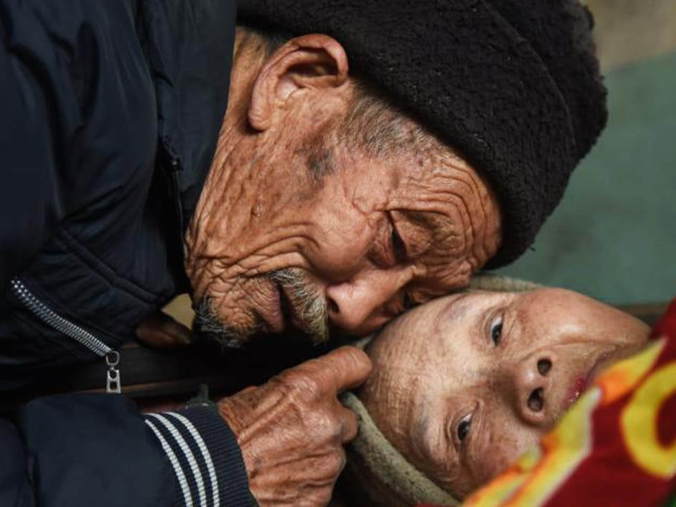 Chinese Pensioner Cares For Paralysed Wife For 56 Years After