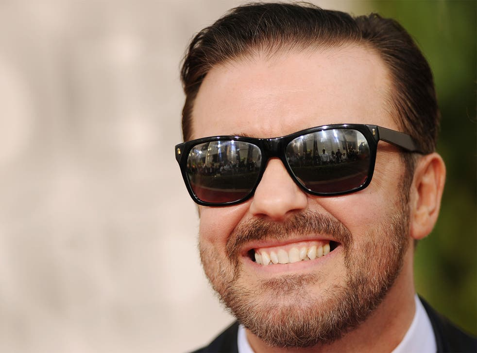 Ricky Gervais said an American journalist praised him for wearing an awful set of false teeth at a film launch, even though he wasn't