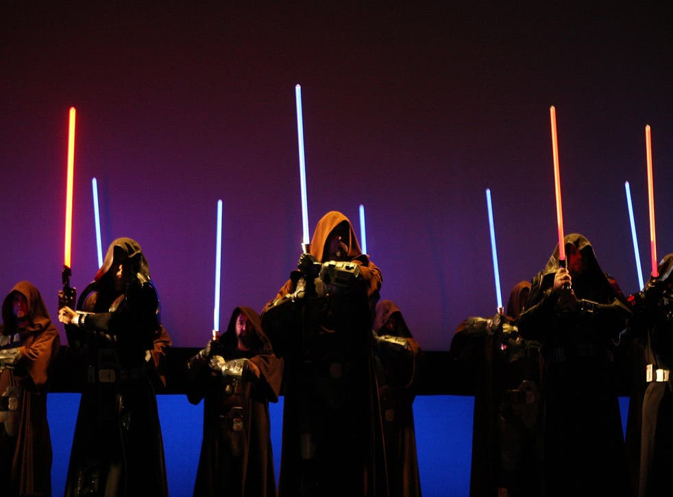 Characters wielding lightsabers take to the stage to promote Star Wars: The Old Republic at E3 in 2009