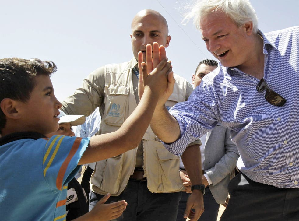 The UN's humanitarian chief Stephen O'Brien greets a young Syrian refugee at the Zaatari camp in Jordan in September