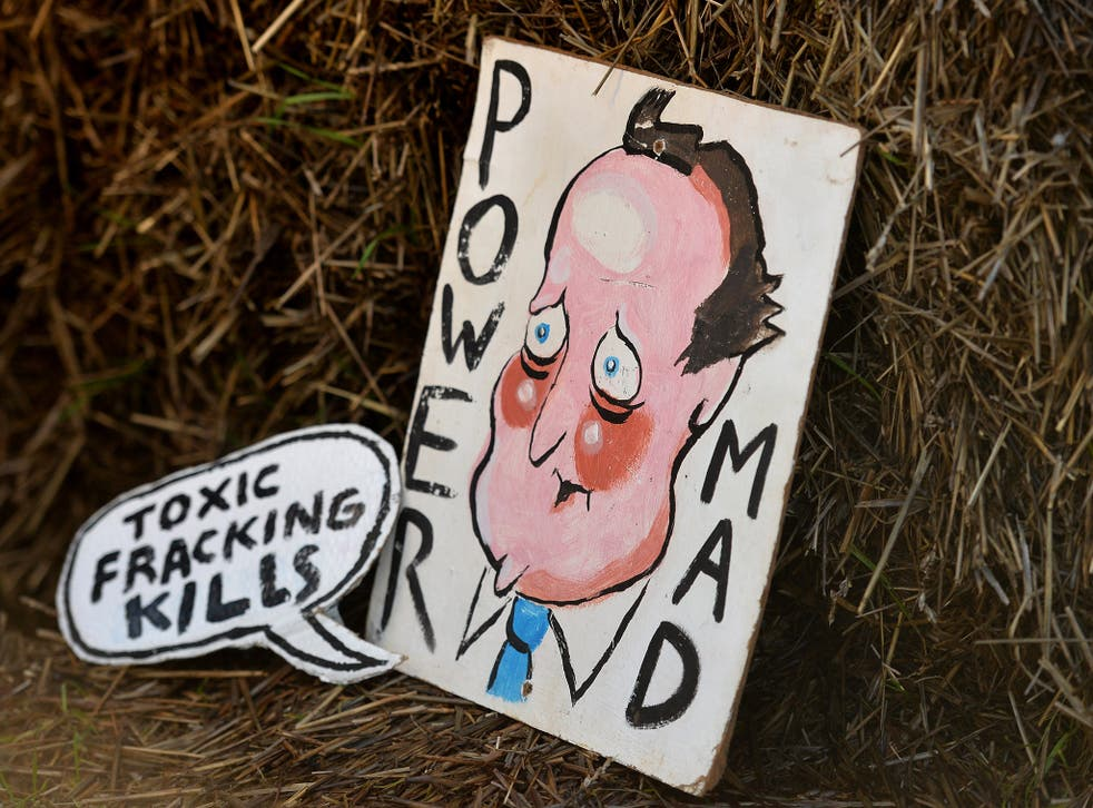 A placard depicting David Cameron at anti-fracking protest in Balcombe last year